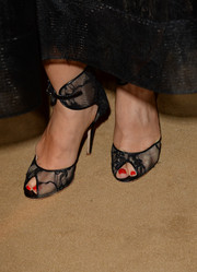 Monique Lhuillier donned an elegant pair of black lace peep-toes featuring wide ankle straps for the Wallis Annenberg Center Inaugural Gala.