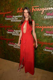 Alessandra Ambrosio turned up the heat at the Wallis Annenberg Center Inaugural Gala in a red Ferragamo evening dress with a navel-grazing keyhole neckline.