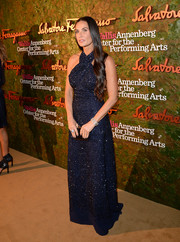 Demi Moore was a stunner in a beaded navy halter gown by Ferragamo at the Wallis Annenberg Center Inaugural Gala.