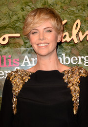Charlize Theron contrasted her glamorous dress with a short messy 'do when she attended the Wallis Annenberg Center Inaugural Gala.