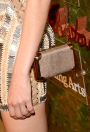 Angela Lindvall accessorized with a silver and gold chain-strap bag when she attended the Wallis Annenberg Center Inaugural Gala.