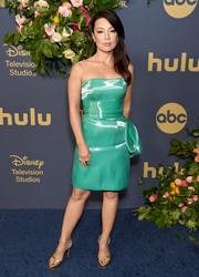 Ming-Na Wen attended the Walt Disney Television Emmy party wearing a strapless green liquid-satin dress by Rubin Singer.