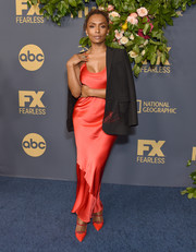 Janet Mock opted for a slinky red slip dress by Valentino when she attended the Walt Disney Television Emmy party.