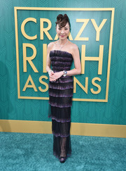 Michelle Yeoh cut a glam figure in a tiered strapless gown by Armani Privé at the premiere of 'Crazy Rich Asians.'
