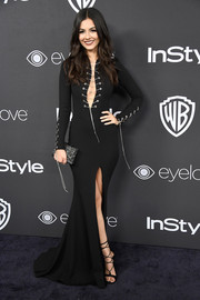 Victoria Justice got majorly vampy in a figure-skimming Julea Domani fishtail gown with a lace-up neckline and sleeves for the Warner Bros. and InStyle Golden Globes post-party.