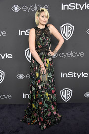 Paris Jackson hovered between sweet and sexy in a semi-sheer lace-panel floral gown by Tadashi Shoji at the Warner Bros. and InStyle Golden Globes post-party.