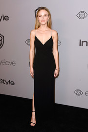 Halston Sage flaunted her slim figure in a form-fitting black velvet gown at the Warner Bros. and InStyle Golden Globes after-party.