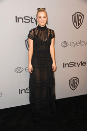 Kaley Cuoco worked the sheer trend with this bead-striped black gown by Elisabetta Franchi at the Warner Bros. and InStyle Golden Globes after-party.