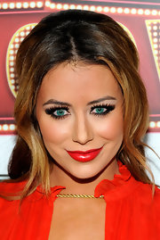 Aubrey certainly made a bold statement with these vibrant red lips. Festive!