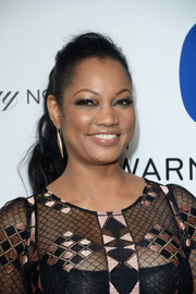 Garcelle Beauvais attended the Warner Music Group Grammy celebration sporting a simple wavy ponytail.