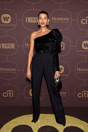 A black satin purse with a bejeweled handle polished off Georgia Fowler's look.