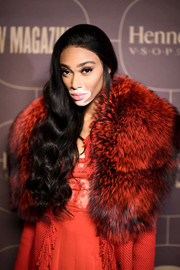 Winnie Harlow looked glam with her long, side-swept curls at the Warner Music Group pre-Grammy celebration.