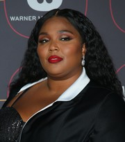 Lizzo added a high dose of glamour with a pair of diamond drop earrings.