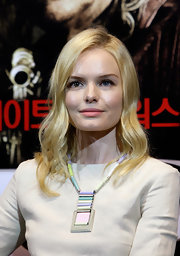 Kate Bosworth paired her sleek long sleeve dress with a pastel statement neckalce.