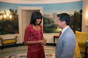 Michelle sported fresh bangs in this rose cocktail dress with velvet burnout filigree.