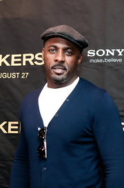 Idris paired her navy blue cardigan with a grey newsboy cap.