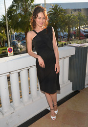 Olga Kurylenko styled her LBD with a pair of white peep-toes with black ankle straps.