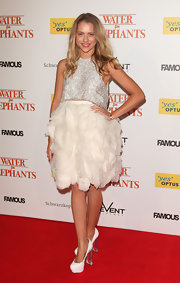 Teresa Palmer complemented her multi-textured red carpet look with white platform pumps with thick lucite heels.