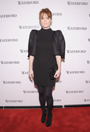 Julianne Moore wore a unique black sweater dress with opaque tights for the Live a Crystal Life event.