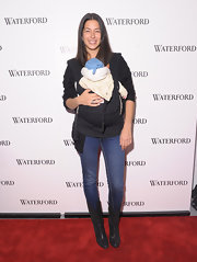 Rebecca was casual-mommy on the red carpet in dark jeans paired with black leather cowboy-inspired boots.