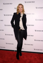 Uma Thurman was winter-ready in black knee-high boots.