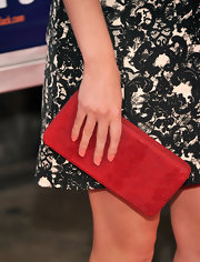 AnnaSophia added a vibrant pop of color to her black and white look by carrying this red clutch.