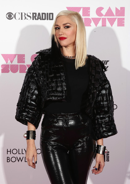 Gwen Stefani styled her shiny black outfit with pearl-accented cuffs on both wrists during the We Can Survive event.
