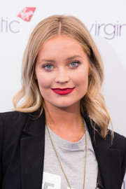 Laura Whitmore chose an eye-popping red hue for her lips.