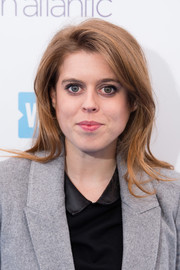 Princess Beatrice wore her hair in a casual straight style while attending WE Day UK.