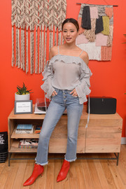 Jamie Chung teamed her top with a pair of cropped jeans.