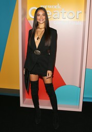 Shanina Shaik completed her edgy-sexy ensemble with a pair of black thigh-high boots.