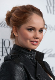 Debby Ryan looked fetching at the Who What Wear event wearing her hair in a delicate bun.