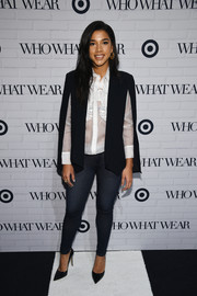 Hannah Bronfman attended the Who What Wear x Target Launch Party in a black cape with armslits that she paired over a white sheer blouse and skinny denin jeans.