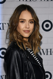 Jessica Alba sported her usual center part with boho waves at the Who What Wear x Target launch.