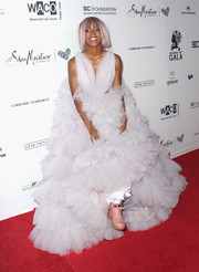 Kelly Rowland went for a fun finish with pink high-top sneakers by Buscemi.
