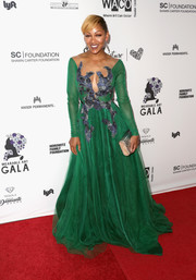 Meagan Good donned a green ball gown with an illusion neckline and blue accents on the bodice for the Wearable Art Gala.