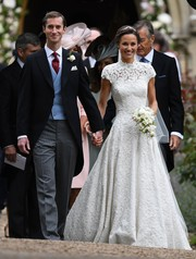 Pippa Middleton looked absolutely captivating in her custom Giles Deacon lace wedding gown!