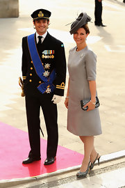 Princess Madeleine held on to a black clutch with a spattering of silver beads as she joined the celebration of the wedding of the Prince of Luxembourg.