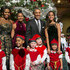 """(AFP OUT) U.S. President Barack Obama (C, R), first lady Michelle Obama (L) and daughters Sasha (C,L) and Malia (R) pose with """"elves"""" prior to the taping of TNT's """"Christmas in Washington"""" program on December 14, 2014 in Washington, DC. The """"elves"""" are former patients of Children's National Medical Center, the beneficiary of this evenings concert."""