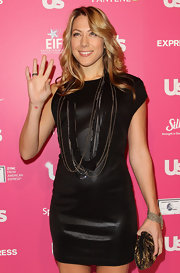 Colbie Caillat accessorized her LBD with a gold glimmering clutch. Matching beaded necklaces completes her lovely look.