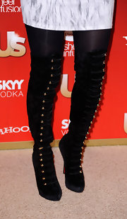 The sexy singer wore a provocative pair of over the knee hook and eye velvet boots. The cute gold hooks were perfect for the holiday season.