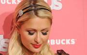 Paris Hilton added high drama to her shiny red lips with fluttering lashes.