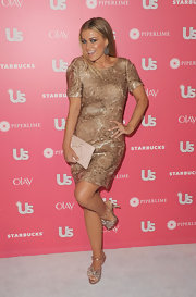Carmen Electra struck a pose in blush metallic bow platform sandals.