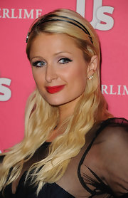Paris Hilton amped up her ravishing look with classic red lipstick. The vivid hue was the perfect way to accent her glamorous look.
