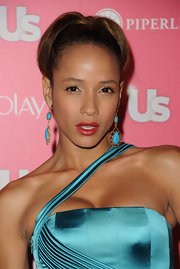 Dania Ramirez paired her high bun with turqouise and gold dangle earrings for the 'Us Weekly Hot Hollywood party.