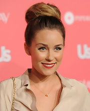 Lauren Conrad rocked a classic high bun full of volume and height at the 'Us Weekly' Hot Hollywood event. She topped off her chic look with vivid red lips.