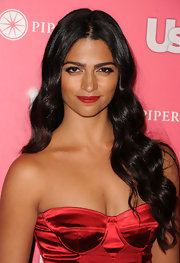 Camila Alves showed off her glamorous side at the 'Us Weekly' Hot Hollywood event with radiant waves and vivid red lipstick.