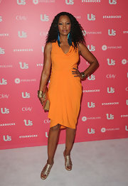 Garcelle Beauvais looked exotic in metallic gold cage sandals.