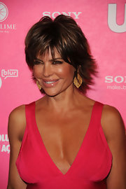 At the 'US Weekly' Hot Hollywood Style issue, Lisa Rinna wore an elaborate pair of gold earrings with her bright strawberry pink dress.