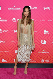 Jamie Chung worked a mismatched-chic look with this white lace pencil skirt and mesh top combo (both by Tome).